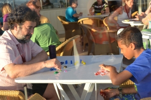 Jesús and the son of one of the conference attendees playing PORTL during the Five Go To Sea cruise.